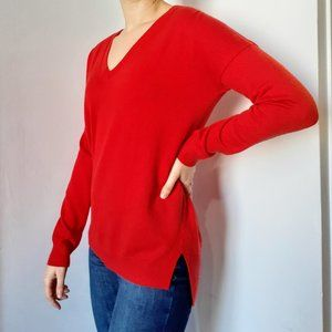 Red V-neck long sleeve sweater
